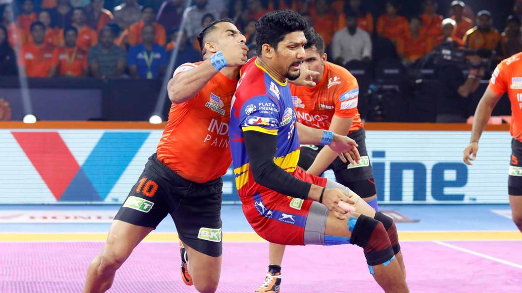 Rishank Devadiga gets the tackle point against Sandeep Narwal