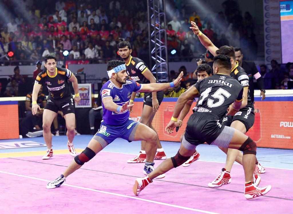 Haryana Steelers' Vikash Khandola showcases his raiding skills against Telugu Titans defence