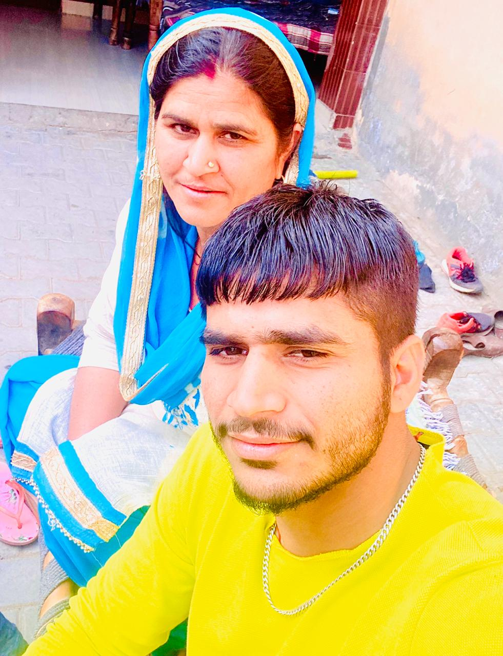 Saurabh Nandal with his mother