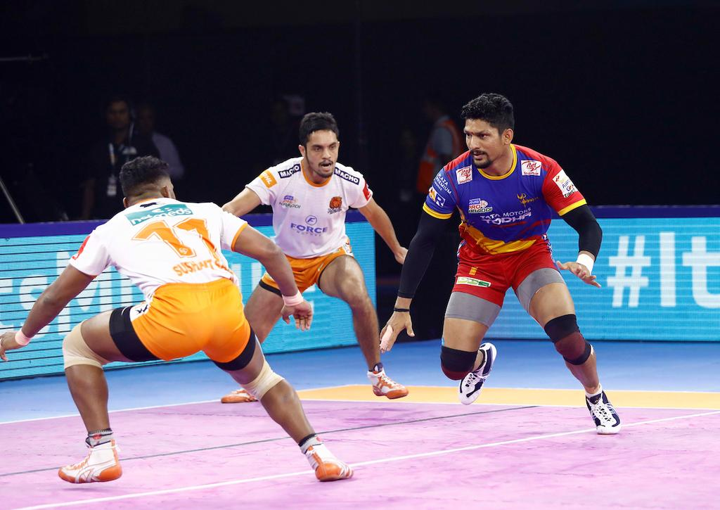 U.P. Yoddha's star raider Rishank Devadiga showcases his raiding skills against Puneir Paltan defense