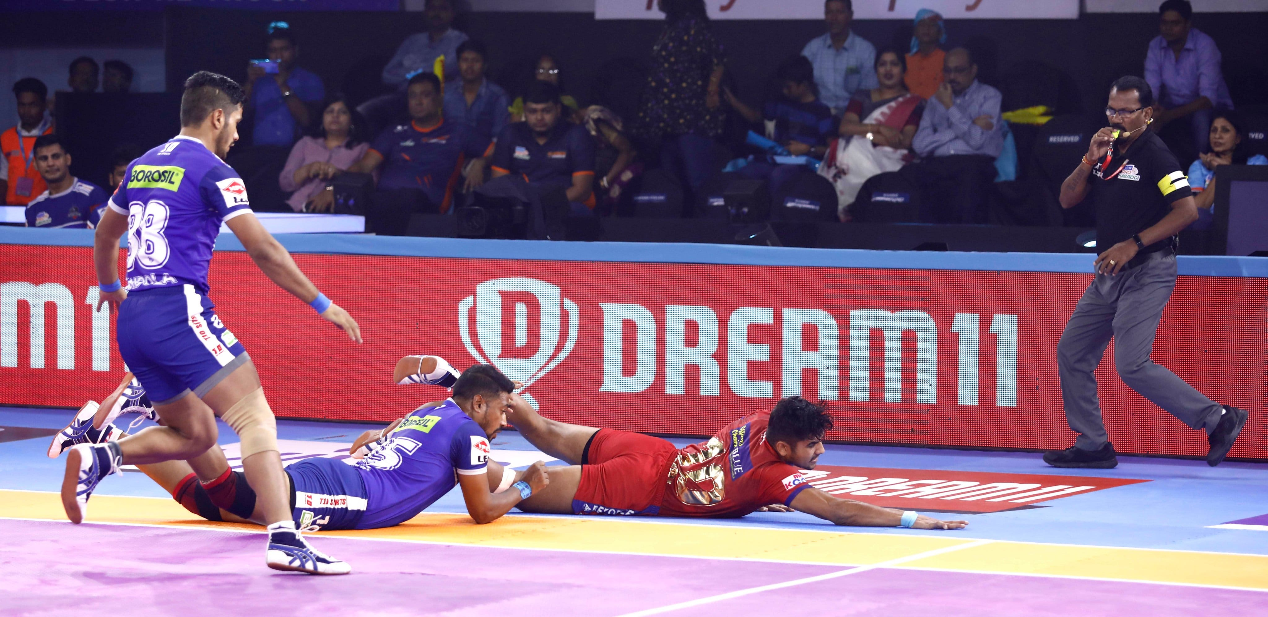 Naveen Kumar is thrown off the mat by Vikas Kale