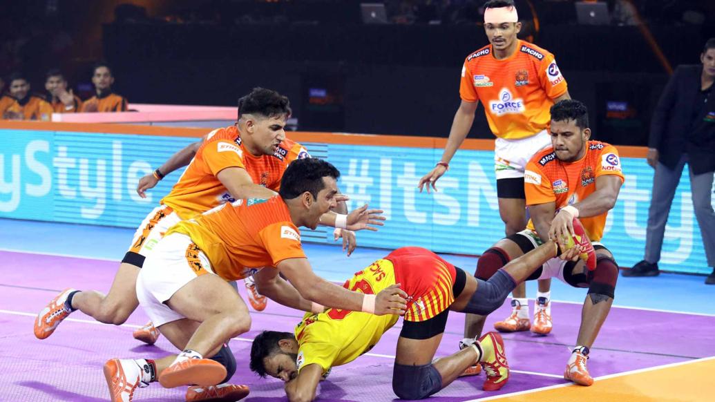 Pune's Surjeet and Girish Ernak tackling a Gujarat player