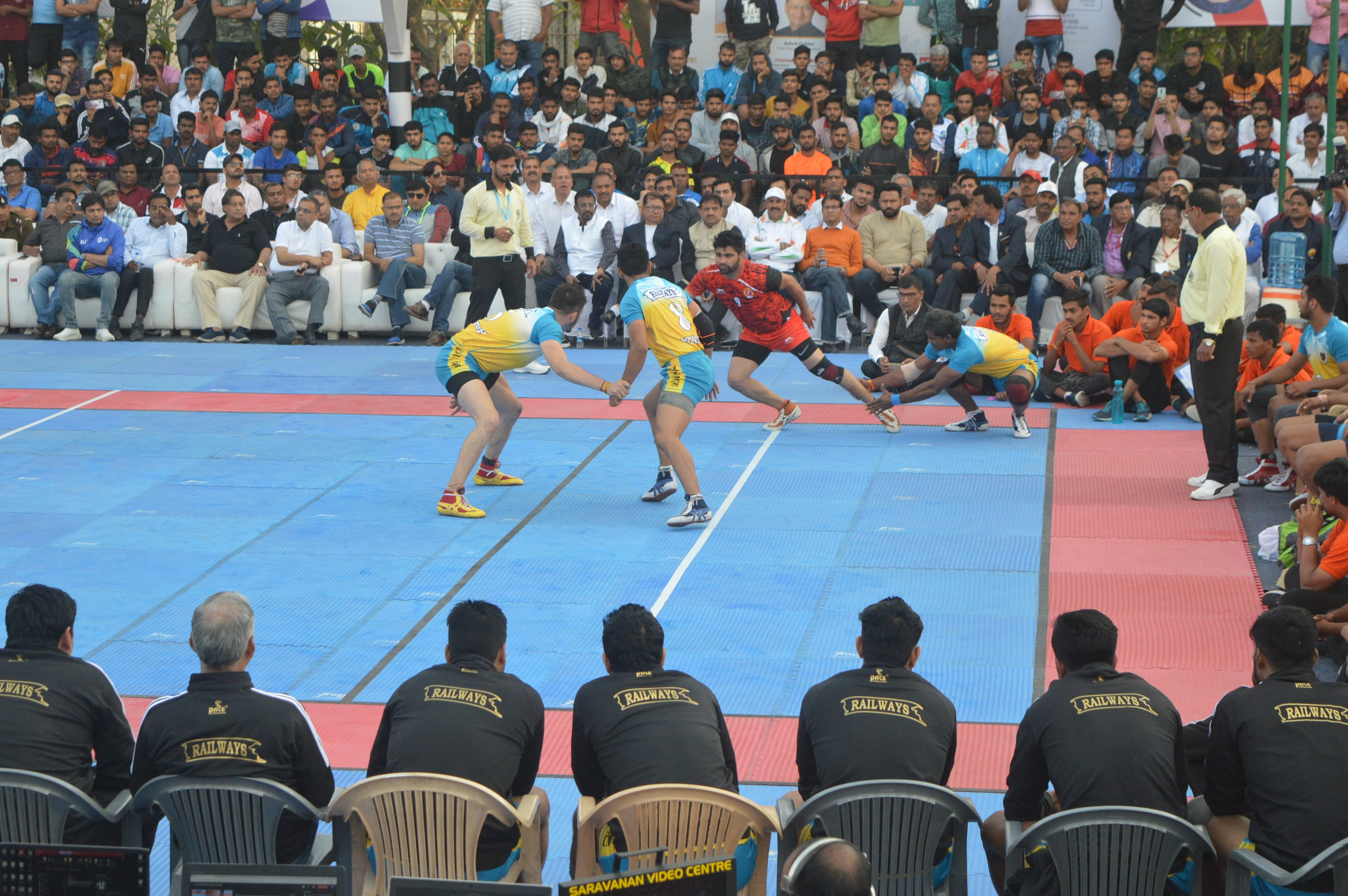 Pardeep Narwal being tackled by Dharmaraj Cheralathan