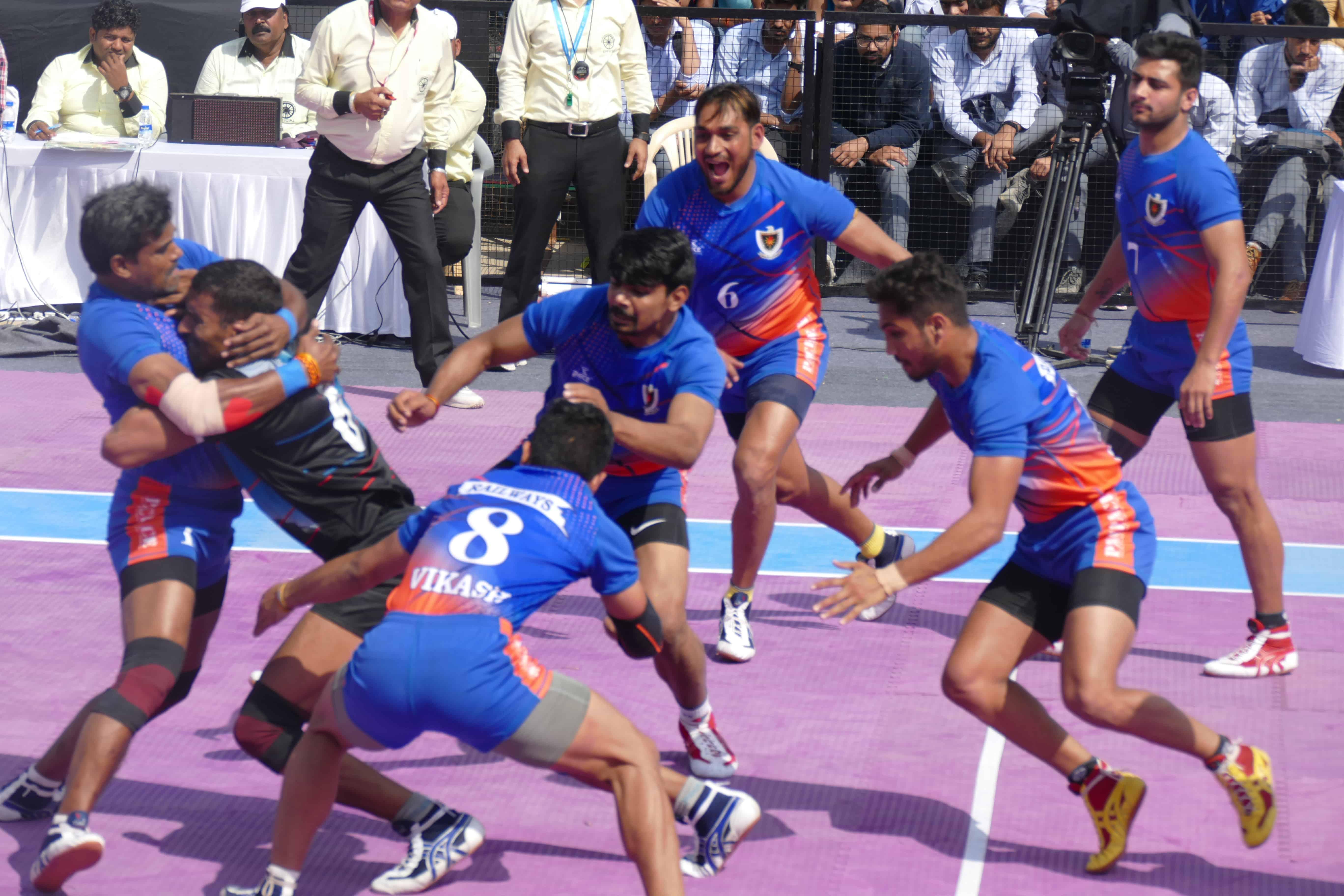 Dharmaraj Cheralathan tackling a raider