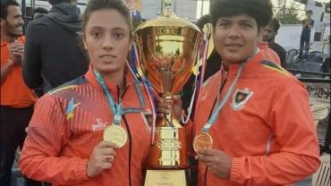 Pinky Roy and Ritu Negi holding 67th Senior National winning Trophy in hand at Poornima University, Jaipur