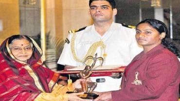 Tejaswini Bai with the Arjuna Award in 2011