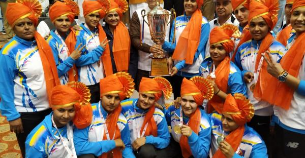 Haryana girls' team with the winning trophy